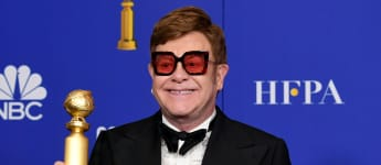 Elton John poses in the press room with the award for Best Original Song - Motion Picture during the 77th Annual Golden Globe Awards at The Beverly Hilton Hotel on January 05, 2020 in Beverly Hills, California