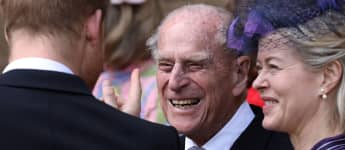 Britain's Prince Philip, Duke of Edinburgh reacts as he talks with Britain's Prince Harry, Duke of Sussex as they leave St George's Chapel in Windsor Castle, Windsor, west of London, on May 18, 2019