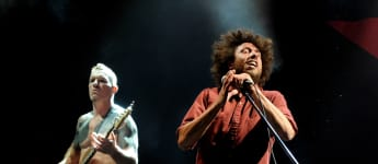 Musician Tim Commerford and singer Zack de la Rocha of Rage Against the Machine performs at L.A. Rising at the L.A. Memorial Coliseum on July 30, 2011 in Los Angeles, California