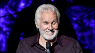 Country Stars Pay Tribute To Kenny Rogers With Special At-Home Covers - See Them Here