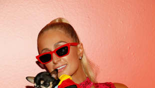 Paris Hilton and her dog attend the Alice + Olivia by Stacey Bendet arrivals during New York Fashion Week on September 9, 2019