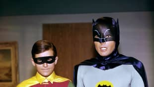 "Adam West and Burt Ward as ""Batman"" and ""Robin"" in the 1960's."