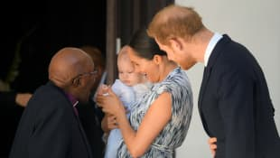 Prince Harry and Meghan holding their son Archie, meet Archbishop Desmond Tutu at the Desmond & Leah Tutu Legacy Foundation in Cape Town, South Africa, September 25, 2019.