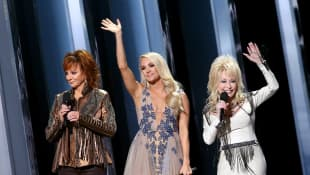 Reba McEntire, Carrie Underwood, Dolly Parton speak onstage during the 53rd annual CMA Awards at the Music City Center on November 13, 2019