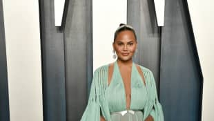 Chrissy Teigen Shares 'Thirst Trap' Swimsuit Photo Of Herself And Her New Dog Petey