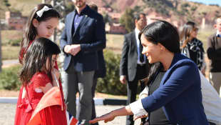 Prince Harry and Duchess Meghan meet Rania and Rayhana Minijam in Asni, Morocco