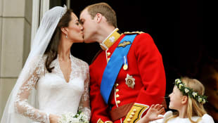 Prince William and Duchess Kate kiss on the balcony of Buckingham Palace