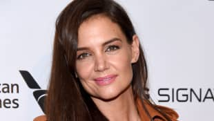 "Katie Holmes talked about her life with daughter Suri and how the ""grew up together""."