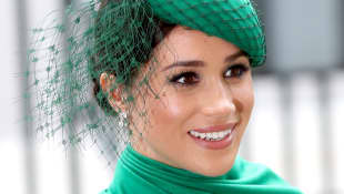 Meghan, Duchess of Sussex meets children as she attends the Commonwealth Day Service 2020 on March 09, 2020