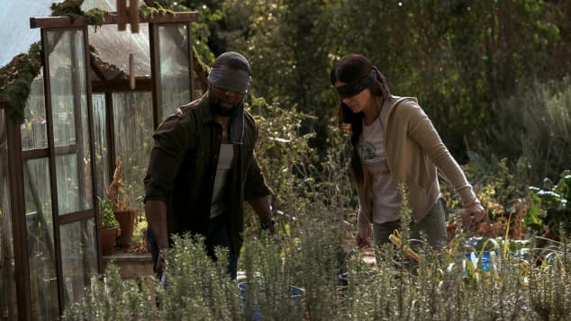 "Sandra Bullock and Trevante Rhodes in the Netflix film, ""Bird Box""."