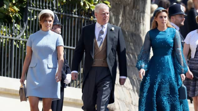 Princess Eugenie, Prince Andrew, Duke of York and Princess Beatrice attend the wedding of Prince Harry to Ms Meghan Markle at St George's Chapel, Windsor Castle on May 19, 2018