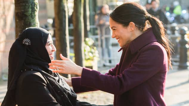Duchess Meghan is greeted by Zaheera Sufyaan as she visits the Hubb Community Kitchen