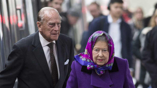 Queen Elizabeth II and Prince Philip arrive at King's Lynn station.