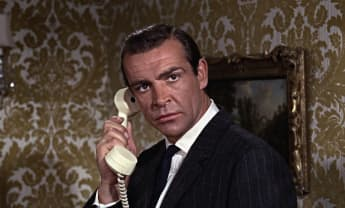 "Sean Connery starred as the iconic spy agent, ""James Bond""."