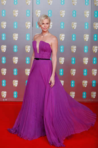 Charlize Theron poses on the red carpet at the BAFTAs on February 2, 2020.