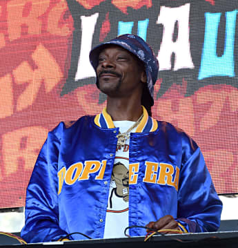 Snoop Dogg performing onstage at the 2019 KROQ Weenie Roast in Dana Point, California.