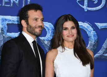 """Aaron Lohr and Idina Menzel at Disney's World Premiere of """"Frozen 2"""" at the Dolby theatre in Hollywood on November 7, 2019"""