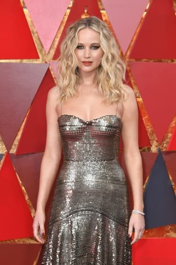 """Jennifer Lawrence Reflects On Falling At The Oscars, Shares It Was """"Devastating"""" Anderson Cooper Said She Faked It"""