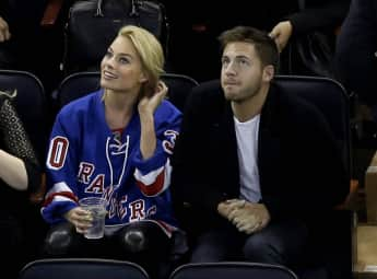 Margot Robbie and Tom Ackerley at an Ice Hockey game