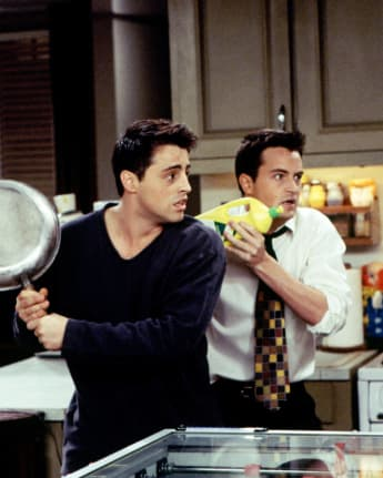 Matt LeBlanc and Matthew Perry in a scene from 'Friends'