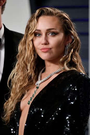 "Miley Cyrus Reveals The First Time She Went ""All The Way With A Dude""!"