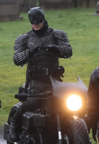 """Robert Pattinson's 'The Batman' Batsuit And """"Batcycle"""" Revealed In New Photos"""