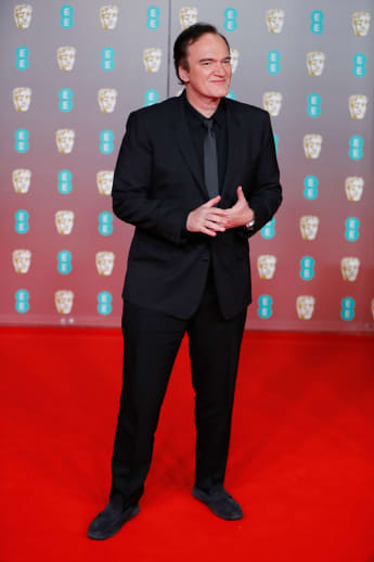 Quentin Tarantino poses on the red carpet at the BAFTAs on February 2, 2020.