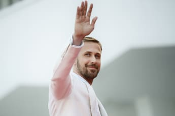 "Ryan Gosling waves as he arrives for the opening ceremony and the premiere of the film ""First Man"", presented in competition at the 75th Venice Film Festival on August 29, 2018"