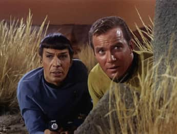 "William Shatner, playing the role of ""Captain Kirk"", and Leornard Nimoy, a.k.a. ""Mr. Spock"""
