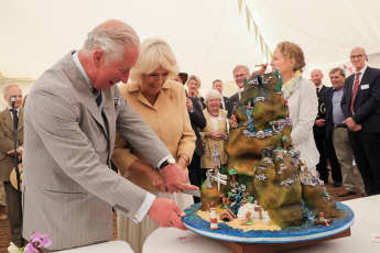 Duchess Camilla and Prince Charles cut a cake on Camilla's 72nd birthday