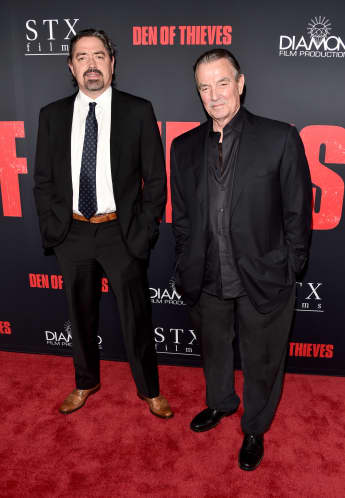 "Christian Gudegast and Eric Braeden attend the premiere of STX Films' ""Den of Thieves"" on January 17, 2018 in Los Angeles, California."