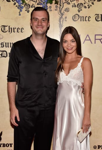 Cooper Hefner and his fiance Scarlett Byrne arrive at Playboy's Midsummer Night's Dream at the Marquee Nightclub on July 28, 2018