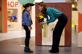 Duchess of Cambridge plays with a child as she visits MiniBrum at Birmingham Science Museum on January 22, 2020