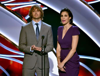Eric Christian Olsen and Daniela Ruah speak onstage at The 41st Annual People's Choice Awards