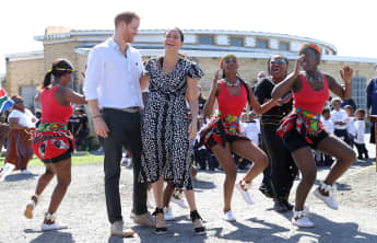 Duchess Meghan and Prince Harry dance during a visit to The Justice Desk on September 23, 2019 in Cape Town, South Africa.
