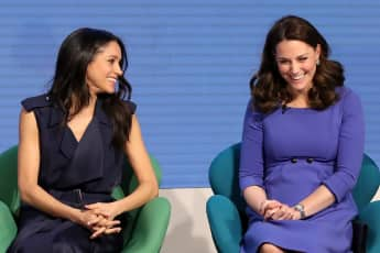 Duchess Meghan and Duchess Catherine laughing together