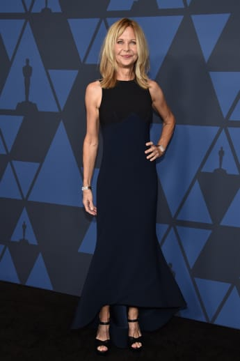 Meg Meg Ryan steps out without her engagement ring. Are things over between her and John Mellencamp?