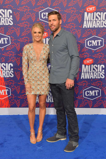 Carrie Underwood and Mike Fisher attend the 2019 CMT Music Awards at Bridgestone Arena on June 05, 2019 in Nashville, Tennessee