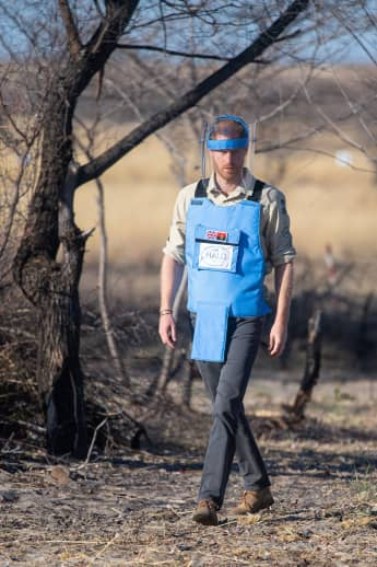 Prince Harry walks through a minefield in Dirico, Angola, during a visit to see the work of landmine clearance charity the Halo Trust, on day five of the royal tour of Africa on September 27, 2019