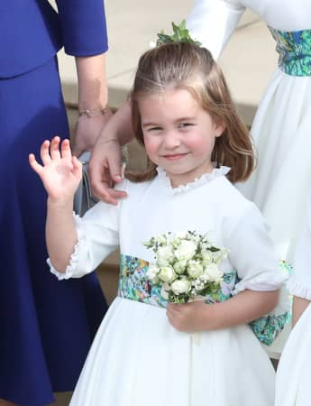 Princess Charlotte at the royal wedding of Princess Eugenie of York and Mr. Jack Brooksbank at St. George's Chapel on October 12, 2018