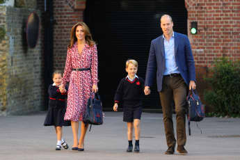 Princess Charlotte, Duchess Catherine, Prince George and Prince William at Thomas's Battersea.
