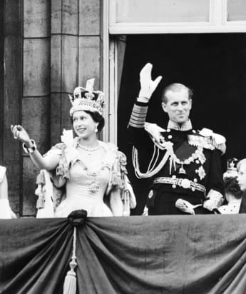 Queen Elizabeth II and Prince Philip wave to the crowd, June 2, 1953 after being crowned at Westminster Abbey in London.