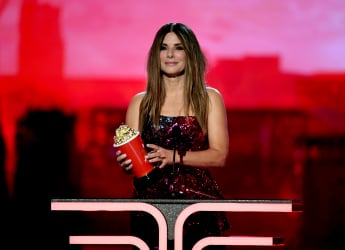 "Sandra Bullock on Modern Parenting Struggles and Sending Her Kids to College ""Down the Street"""