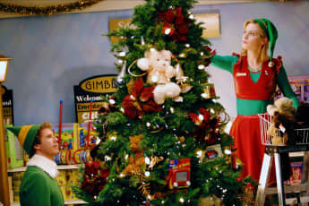 """Zooey Deschanel starred in Elf as """"Jovie"""" who falls in love with """"Buddy"""" (Will Ferrell)"""