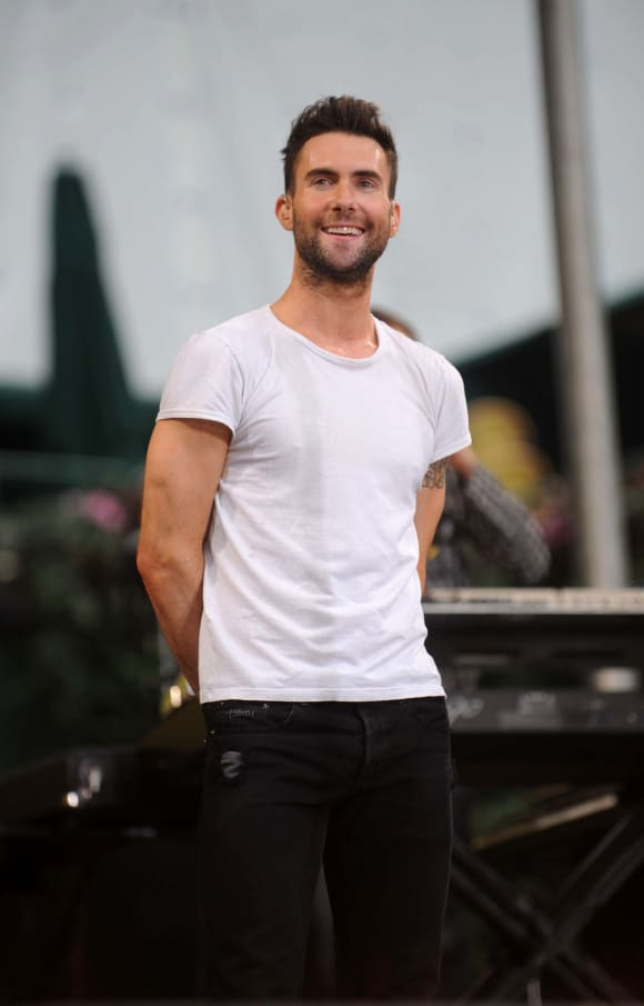 """Adam Levine of Maroon 5 performs on ABC's """"Good Morning America"""" on June 27, 2008 at Bryant Park in New York City."""