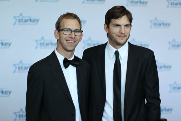 Ashton Kutcher with his twin brother Michael