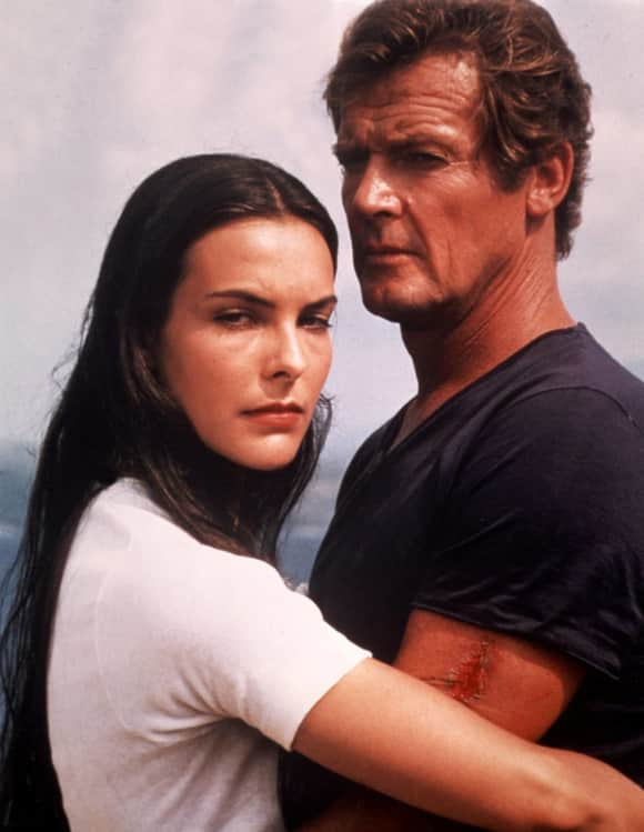 Carole Bouquet and Roger Moore