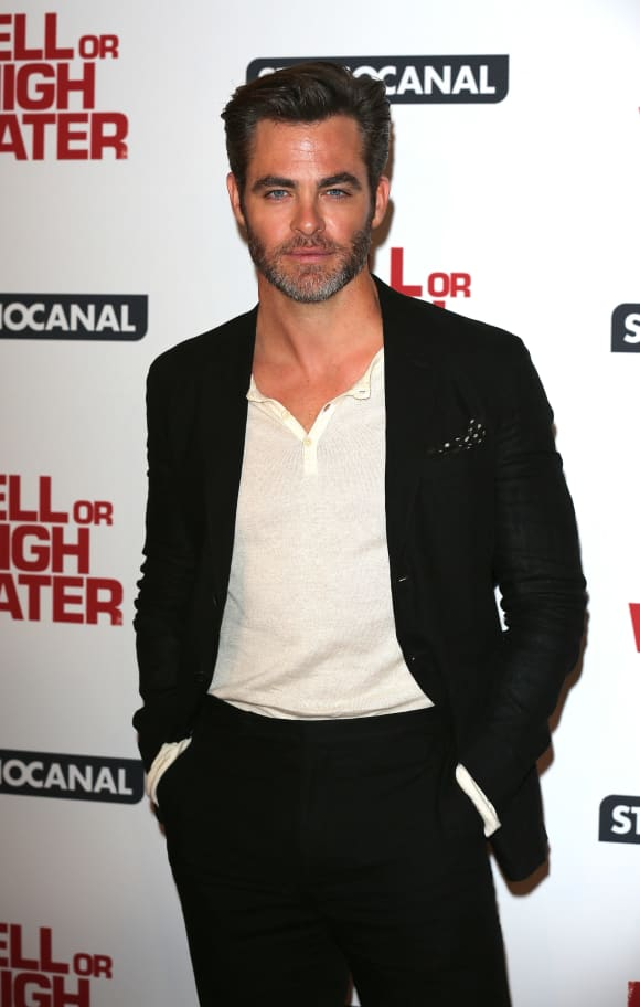 Chris Pine poses for a photo at the gala screening of Hell or High Water.