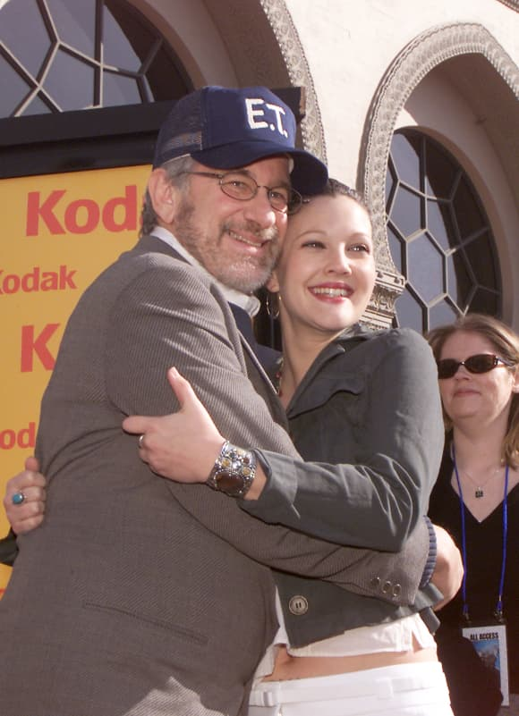 """Steven Spielberg and Drew Barrymore at the 20th anniversary premiere of """"E.T. The Extra-Terrestrial"""" at the Shrine Auditorium in Los Angeles, Ca. Saturday, March 16, 2002"""