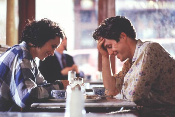 "Andie MacDowell and Hugh Grant in ""Four Weddings and a Funeral"""